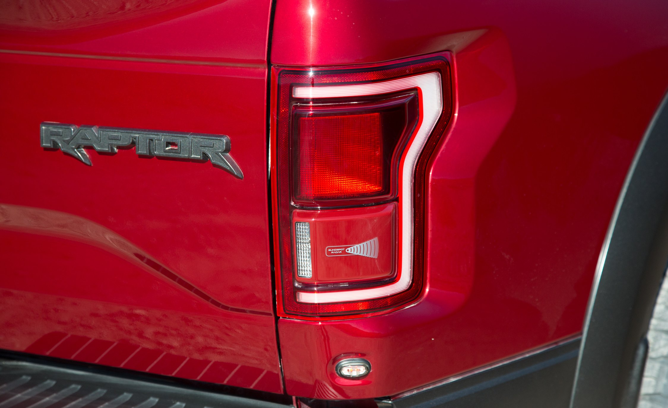 2017 Ford F 150 Raptor SuperCab Exterior View Taillight And Badge (View 44 of 47)