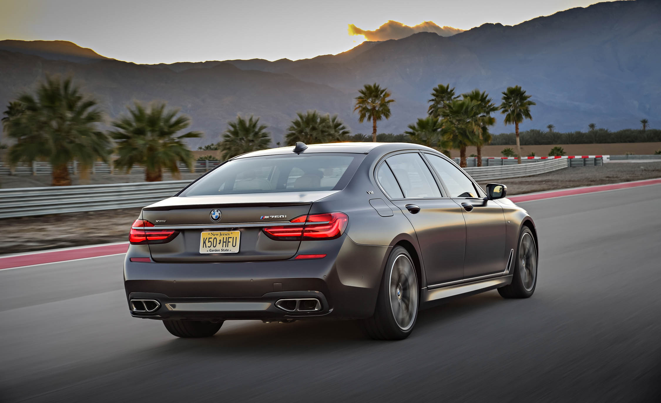 2017 BMW M760i XDrive Test Drive Grey Metallic Rear And Side (Photo 45 of 76)