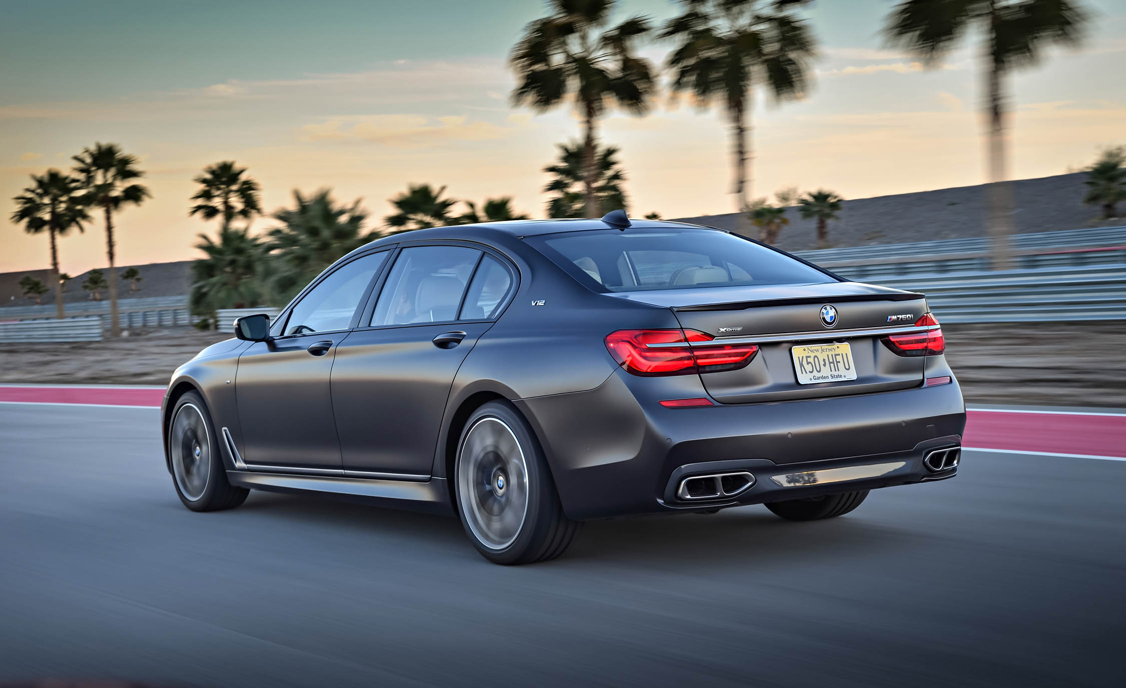 2017 BMW M760i XDrive Test Drive Grey Metallic Side And Rear View (Photo 50 of 76)