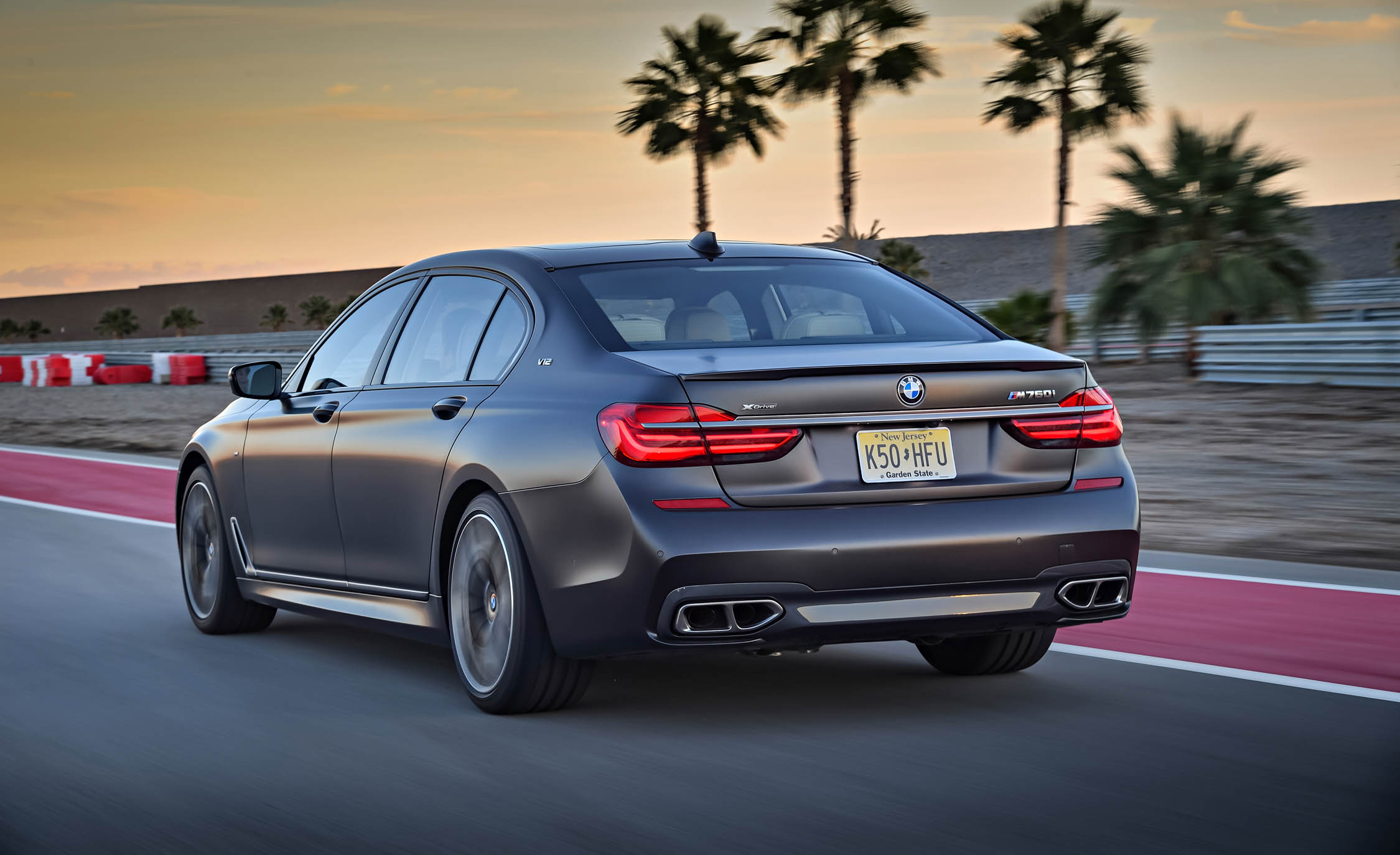 2017 BMW M760i XDrive Test Drive Grey Metallic Side And Rear (Photo 47 of 76)