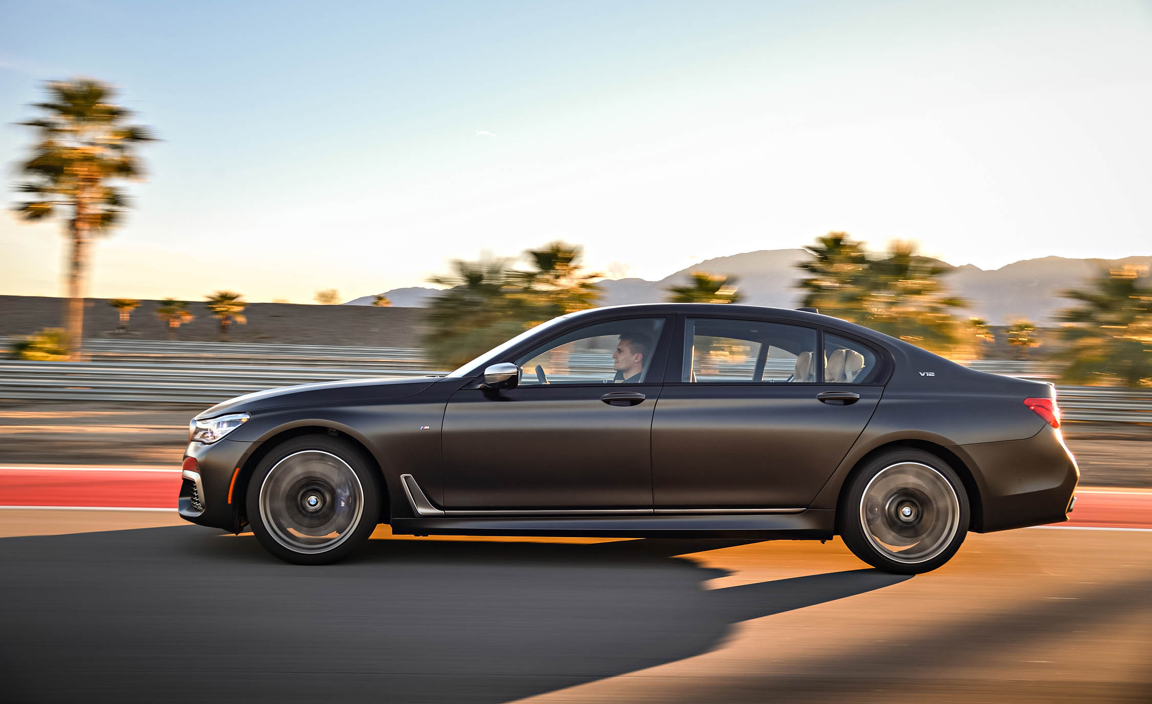2017 BMW M760i XDrive Test Drive Grey Metallic Side Left View (Photo 52 of 76)