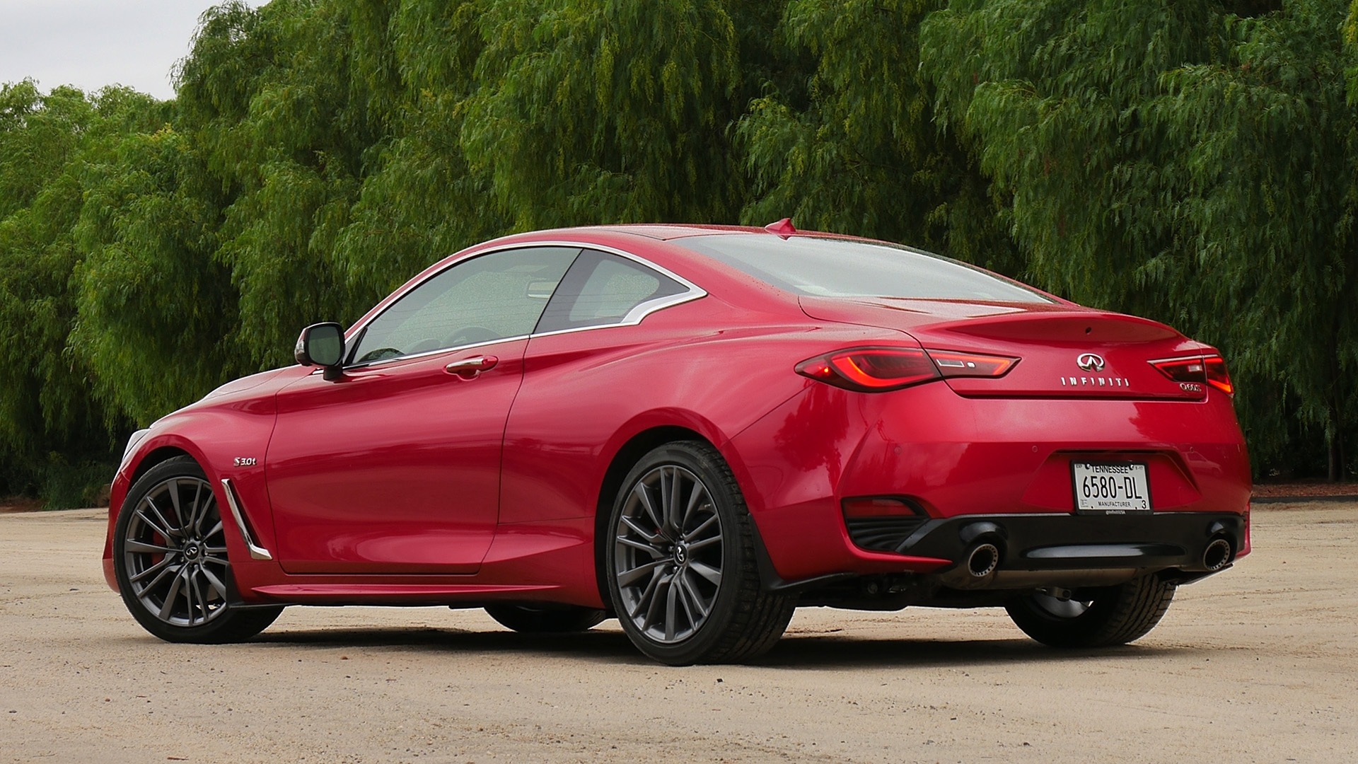 2017 Infiniti Q60 Red Exterior Rear And Side View (Photo 17 of 32)