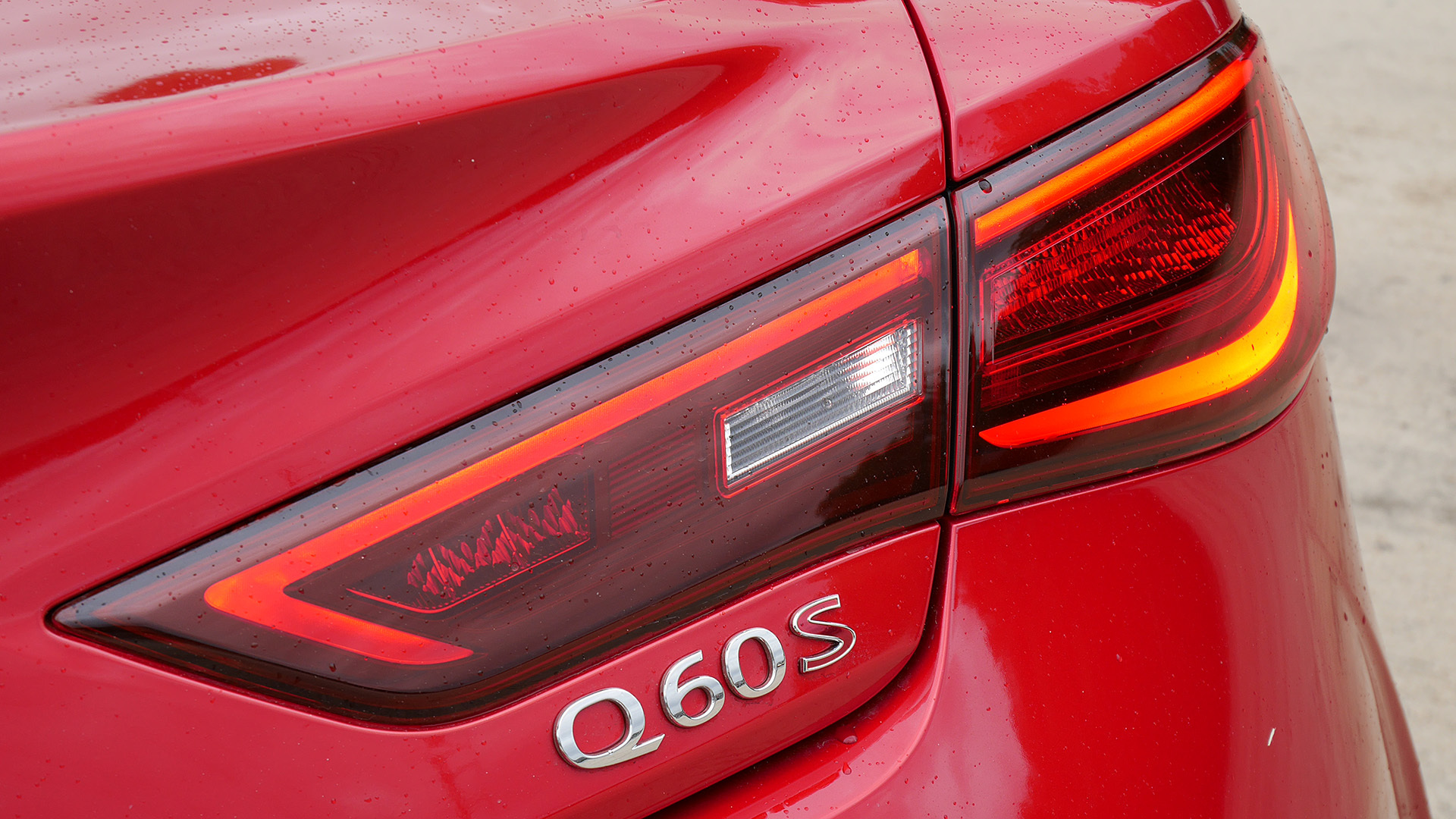 2017 Infiniti Q60 Red Exterior View Rear Emblem (Photo 23 of 32)
