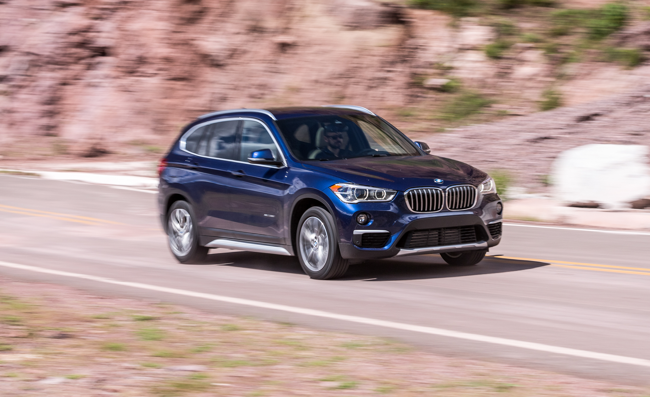 2016 BMW X1 XDrive28i Blue Metallic Test Drive Front And Side View (Photo 8 of 36)