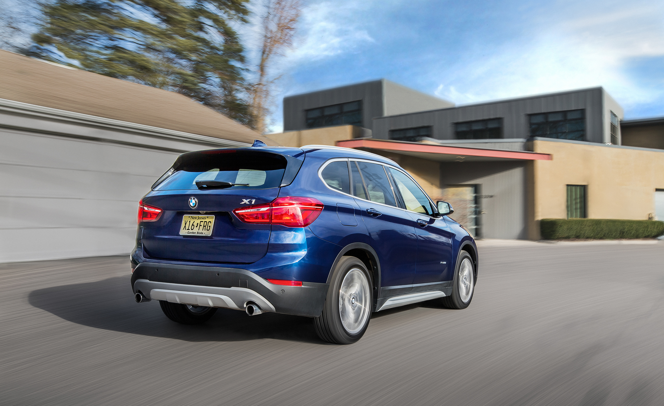 2016 BMW X1 XDrive28i Blue Metallic Test Drive Rear And Side View (View 4 of 36)