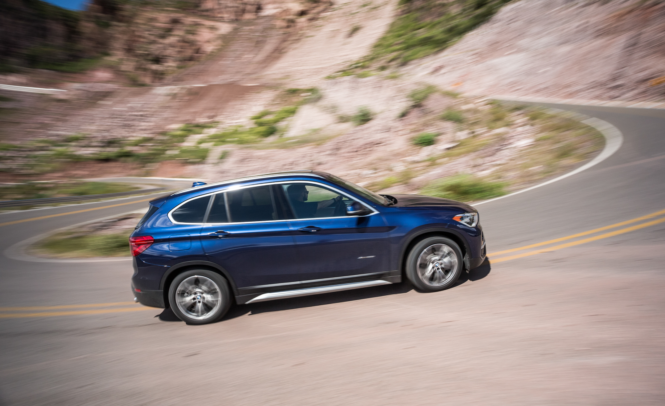 2016 BMW X1 XDrive28i Blue Metallic Test Drive Side View (Photo 34 of 36)